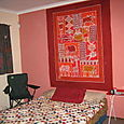 Bed room w/ table cloth wall hanging